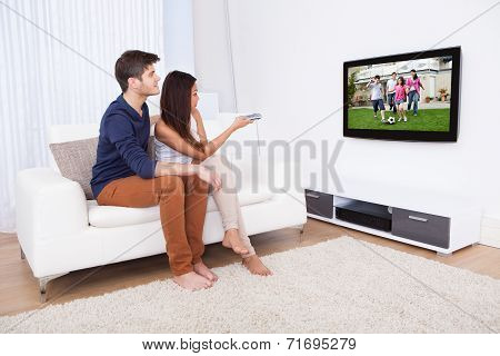 Couple Watching Tv In Living Room
