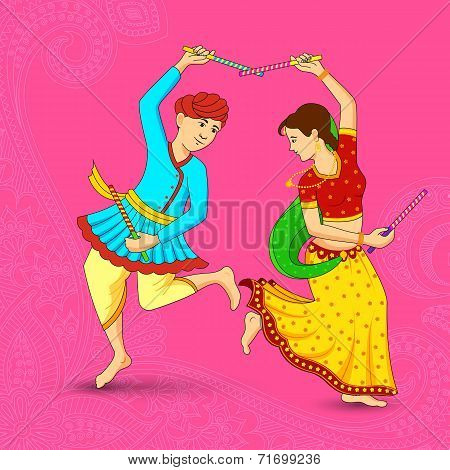 Man and woman dancing on Dandiya night