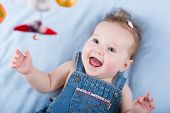 picture of girl toy  - Sweetest Baby Girl Playing With A Colorful Mobile Toy