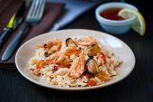 foto of rice noodles  - Thai dish of stir fried rice noodles with prawns and mussels - JPG