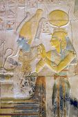 stock photo of isis  - Ancient Egyptian painted and carved image of the gods Osiris seated with Isis behind him - JPG