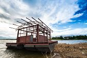 stock photo of pontoon boat  - Steel pontoon under construction The lake The blue sky - JPG
