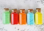 picture of pigment  - Bottles with colorful dry pigments on wooden background - JPG