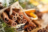 stock photo of wooden basket  - Cinnamon Sticks In Basket For Christmas day - JPG