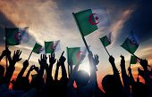 picture of algeria  - Silhouettes of People Holding Flag of Algeria - JPG