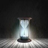 picture of hourglass figure  - Conceptual image with huge sandglass - JPG