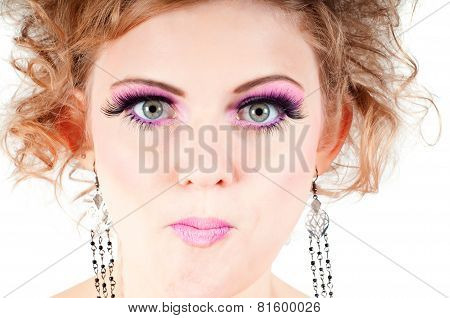 Blonde with fancy make-up grimacing