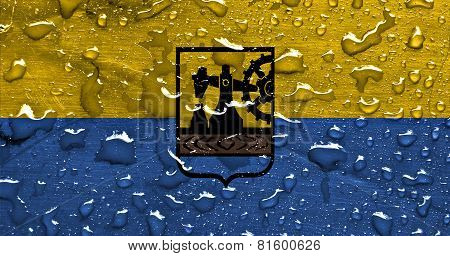 a flag of Katowice with rain drops