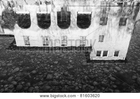 House reflection in water