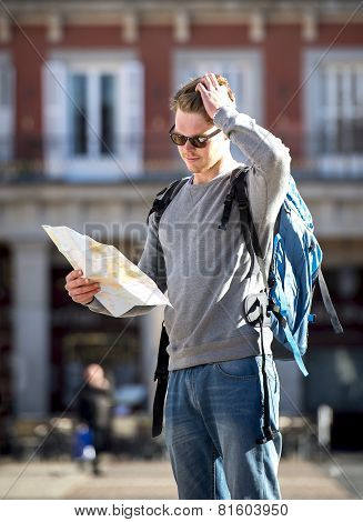 Young Student Backpacker Tourist Looking City Map In Holidays Travel