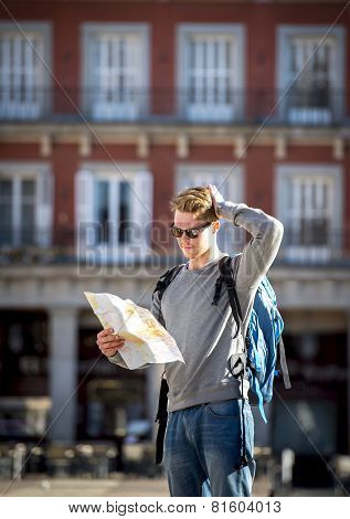 Young Student Backpacker Tourist Looking City Map Lost And Confused In Travel Destination