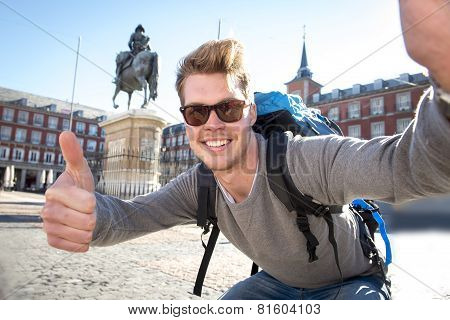 Student Backpacker Tourist Taking Selfie Photo With Mobile Phone Outdoors