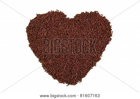 Heart shape formed with chocolate sprinkles isolated on white background. Love concept. Valentine's