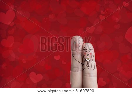 Finger art of a Happy couple. Man is giving a flower. Stock Image