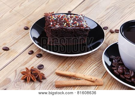 sweet food : hot black fragrant coffee and chocolate cake with cinnamon sticks, coffee beans, anise star