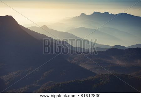 Valley with mountains at sunrise. View from Adam's peak, Sri Lanka