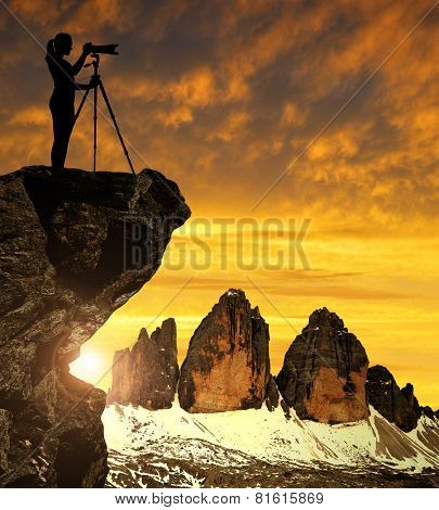 Photographer photographing the sunset over the Tre Cime di Lavaredo ,Dolomite Alps, Italy