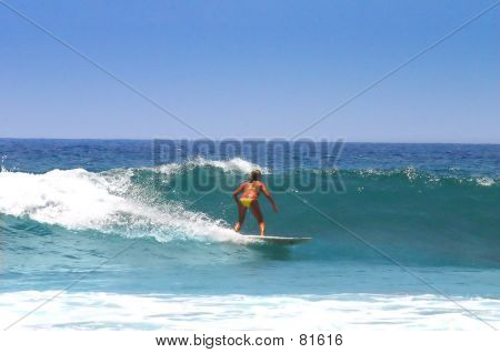 Surfer Riding Waves