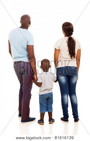 back view of young african family holding hands isolated on white