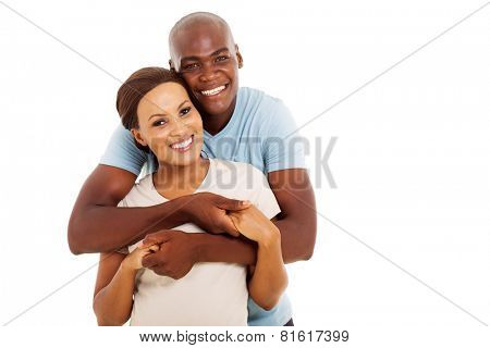 lovely young black couple looking at the camera on white background