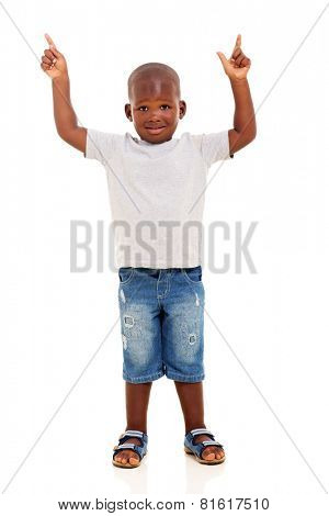 cute little african american boy pointing up with both hands