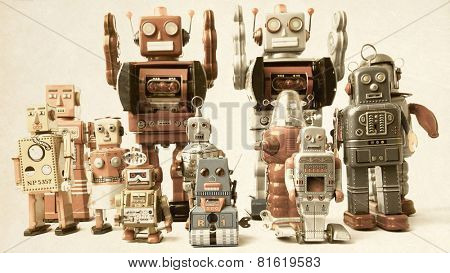 a team of  vintage robot toys
