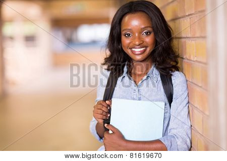 gorgeous african college student with books