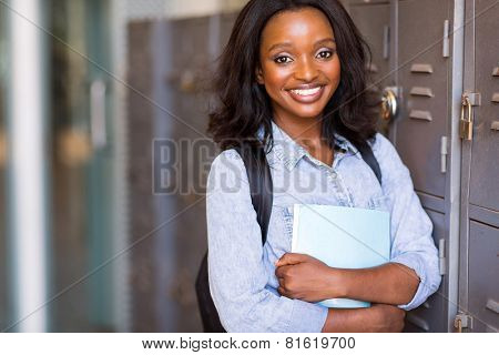 pretty female afro american university student next to lockers