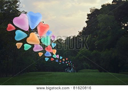 Colorful Heart Love Balloon Float On Air With Bicycle At Park
