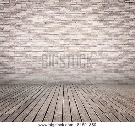 room with white bricks wall and wood floor