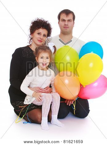 Happy young family with balloons.