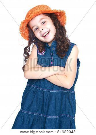 Beautiful little girl in an orange hat.