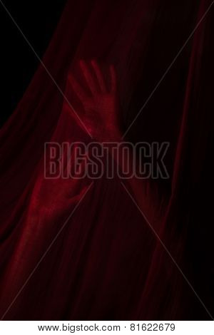 Girl posing with red fabric