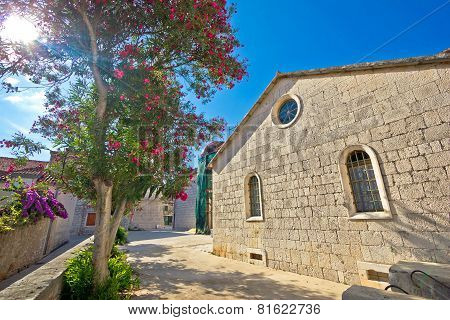 Stone Church And Flowers Of Hvar Island