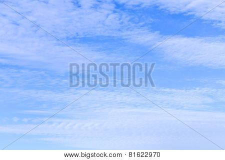 Blue Sky With Small Puffy Clouds