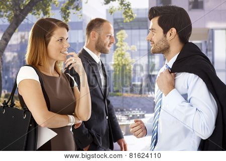 Attractive businesswoman flirting with colleague after meeting on the street.