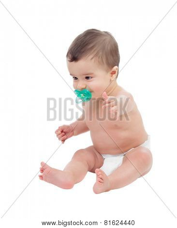 Adorable six month baby in diaper witn pacifier isolated on white background