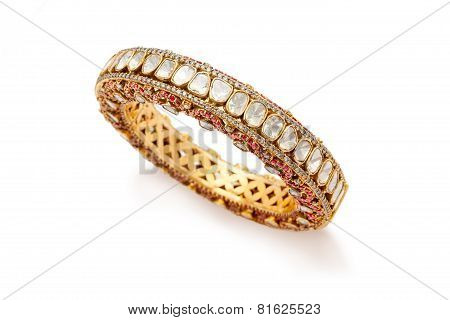 Close up of designer golden bangle