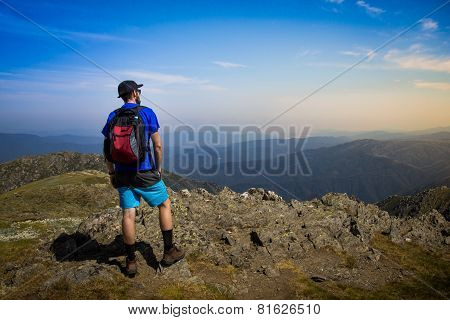 Male Hiker Looking Out Over Mountains