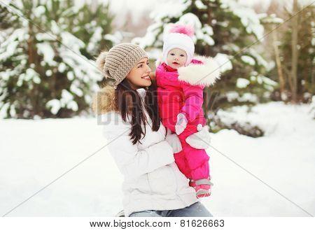Happy Family In Winter Snowy Day