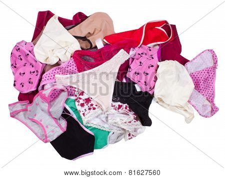 Lots of messy colorful clothes isolated on white