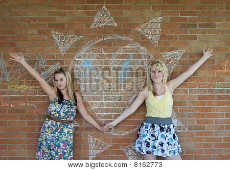 Two Girls Next To A Heart