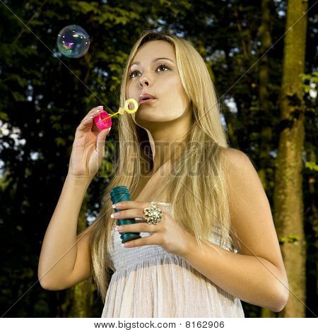 Blonde Blowing Soap Bubble