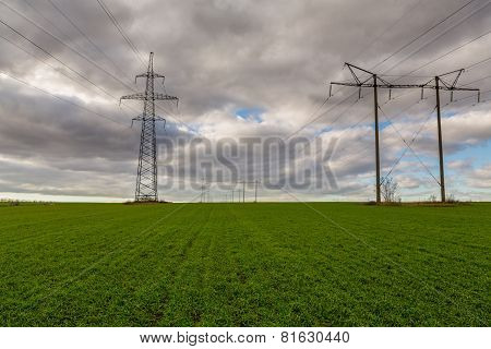 Power Pylons In A Field On A Foggy Morning In The Netherlands