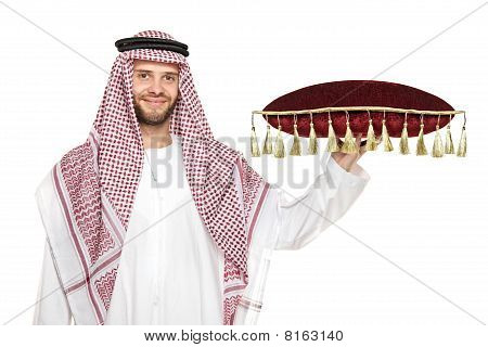 An arab person holding a pillow