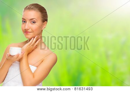 Young healthy girl with body cream isolated