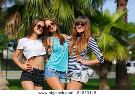 Beautiful girls are photographed on a tropical resort on a background of green nature.
