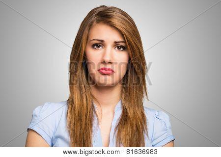Closeup portrait of a sad woman