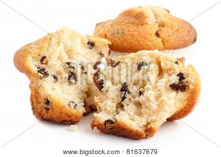 Broken light chocolate chip muffin on white
