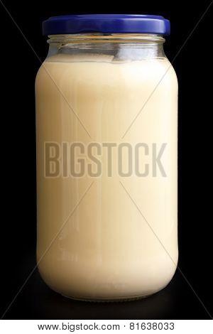 Glass mayonnaise jar with blue lid on black